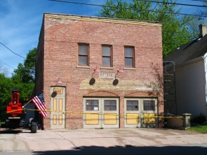 Photo of the front of the SAHS firehouse with progress made on restoration